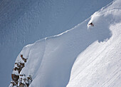 Jessica Baker rips a steep, powder line in No Shadows off of Cody Peak in the Jackson Hole backcountry off of Jackson Hole Mountain Resort in Jackson, Wyoming, USA.