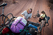 Riders rig a toyota truck with mountain bikes while touring the White Rim Trail near Moab, Utah.