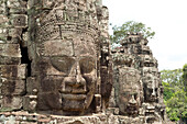 Huge faces carved in stone, Bayon Temple, UNESCO World Heritage Site, Angkor, Siem Reap, Cambodia, Indochina, Southeast Asia, Asia