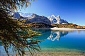 The majestic Marmolada Group and the Lake Fedaia with its turquoise waters, Dolomites, Italy, Europe