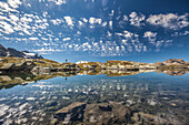 The reflection of the Engadine sky in the the magic of the crystal-clear mountain lakes, Sils, Engadine, Graubunden, Switzerland, Europe