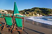 Sun umbrella and chair at the beach of Levanto, Riviera de Levanto, Cinque Terre, Liguria, Italy, Europe