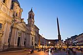 Tourists enjoying Bernini's Fontana dei Quattro Fiumi (Fountain of Four Rivers) in Piazza Navona, Rome, Lazio, Italy, Europe