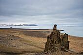 Unique sandstone formation in a barren landscape on Freemansundet, Svalbard, Arctic