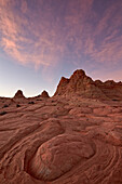 Swirl erosion pattern with pink clouds at dawn, Coyote Buttes Wilderness, Vermillion Cliffs National Monument, Arizona, United States of America, North America