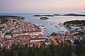 Hvar Town at sunset taken from the Spanish Fortress (Fortica), Hvar Island, Dalmatian Coast, Adriatic, Croatia, Europe
