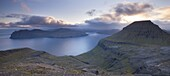 Looking towards the Island of Vagar from the mountains of Streymoy, Faroe Islands, Denmark, Europe