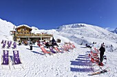 Skiers relaxing at cafe in winter sunshine, Verdons Sud, La Plagne, French Alps, France, Europe