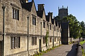 Row of Alms houses and St. James Cotswold wool church, Chipping Campden, Gloucestershire, Cotswolds, England, United Kingdom, Europe