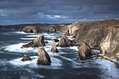 Rugged coastline being pounded by waves on the West coast of Lewis at Mangersta, Isle of Lewis, Outer Hebrides, Scotland, United Kingdom, Europe