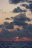 Seascape with clouds in the sky at sunset