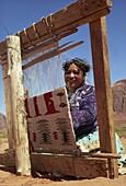 Navajo woman weaving carpet, Monument Valley, Arizona, United States of America, North America