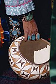 Close-up of turquoise jewellery on the hand of an Indian holding a decorated bowl, New Mexico, United States of America, North America