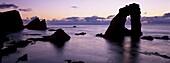 Gaada Stack natural arch, 45 m high, at sunset, Foula, Shetland Islands, Scotland, United Kingdom, Europe
