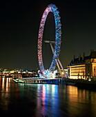 London Eye illuminated by moving coloured lights, London, England, United Kingdom, Europe