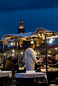 Cook selling food from his stall in the Djemaa el Fna, Place Jemaa El Fna (Djemaa El Fna), Marrakech (Marrakesh), Morocco, North Africa, Africa
