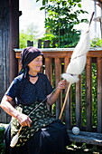 Elderly woman spinning wool, Ieud, Maramures, Romania, Europe