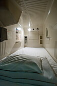 Interior view of single-person sleeping compartment at capsule hotel in Osaka, Japan, Asia