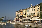 Harbour entrance and quayside cafes, Lazise, Lake Garda, Veneto, Italy, Europe