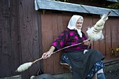 Elderly woman spinning wool, Budesti, Maramures, Romania, Europe