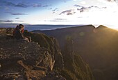 Two pople on a mountain platform, looking at an awe inspiring sunrise, Le Maido, Reunion, Indian Ocean, Africa
