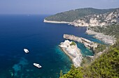 Aerial view of dramatic limestone formations at Bougazi and Avlaki, west coast, Paxos, Ionian Islands, Greek Islands, Greece, Europe