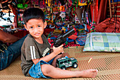 Young boy with toy pistol, Coron, Busuanga, Palawan, Philippines, Asia