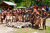 Tribespeople pose after traditional dance and firewalking performance, Biak, Papua, Indonesia, Asia