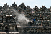 Man sandblasts at Borobudur Temple, Borobodur, Central Java, Java, Indonesia, Asia