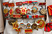 Medals worn by a Vietnamese war veteran visiting the former prison and now museum, Phu Quoc, Mekong Delta, Vietnam, Asia