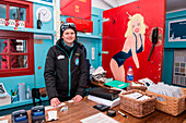 The shop at Base A of the British Antarctic Survey scientific stations sells hats, t-shirts, magnets, collectors-edition stamps, books, and Antarctic tartans. Visitors from expedition cruise-ships can pay with dollars, euros, British pounds or with their