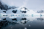 On windstill days, when the mountains and glaciers are reflected in the water's surface, Paradise Bay seems even more magical, Paradise Bay (Paradise Harbor), Danco Coast, Graham Land, Antarctica