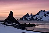 Rugged rocks and mountains at sunrise, Half Moon Island, South Shetland Islands, Antarctica