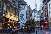 Outdoor cafes and Brousaille wall mural of a couple walking arm in arm, Brussels, Belgium, Europe
