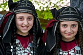 Young traditionally dressed Georgian girls, Sighnaghi, Georgia, Caucasus, Central Asia, Asia