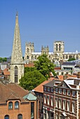 York Minster, northern Europe's largest Gothic cathedral, the spire of St Mary's church, and the skyline of the city of York, Yorkshire, England, United Kingdom, Europe