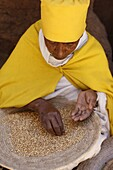 Nun sorting wheat in Bet Maryam church courtyard, Lalibela, Wollo, Ethiopia, Africa