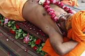 Guru lying on a bed of nails in Pilot Baba camp at Kumbh Mela in Haridwar, Uttarakhand, India, Asia