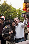 Tourists taking their own photograph at Yu Yuan Garden, Huangpu District, Shanghai, China, Asia
