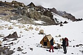 Climbers and hut at camp Berlin at 6000m, Aconcagua 6962m, highest peak in South America, Aconcagua Provincial Park, Andes mountains, Argentina, South America