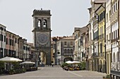Street cafes and the Town Gate with ornamental clock tower, Este, Veneto, Italy, Europe