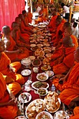 Monks eating a meal on Meak Bochea (Makha Bucha) holiday, Udong, Cambodia, Indochina, Southeast Asia, Asia