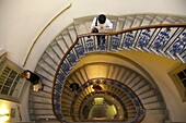 Visitors on  circular stairway, Courtauld Galleries, Somerset House, London, England, United Kingdom, Europe