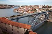 The Dom Luis 1 Bridge over the River Douro showing Porto Metro light rail in transit and Arrabida Bridge in background, Porto (Oporto), Portugal, Europe
