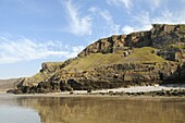 Coastal cliffs at Rhossili, viewed from below at low tide, The Gower peninsula, Wales, United Kingdom, Europe