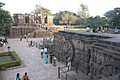Visitors at the 13th century Konarak Sun temple, built as a chariot for Surya, the sun god, in the afternoon, UNESCO World Heritage Site, Konarak, Orissa, India, Asia