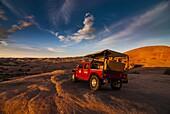 Hummer jeep on the Slickrock Trail at sunset, Moab, Utah, United States of America, North America