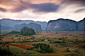 Dusk view across Vinales Valley showing limestone hills known as Mogotes, Vinales, UNESCO World Heritage Site, Cuba, West Indies, Central America