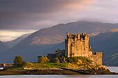 Eilean Donan Castle bathed in evening light, Loch Duich, near Kyle of Lochalsh, Highland, Scotland, United Kingdom, Europe