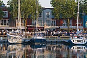 Open-air restaurants overlooking yachts moored in the ancient harbour at La Rochelle, Charente-Maritime, France, Europe